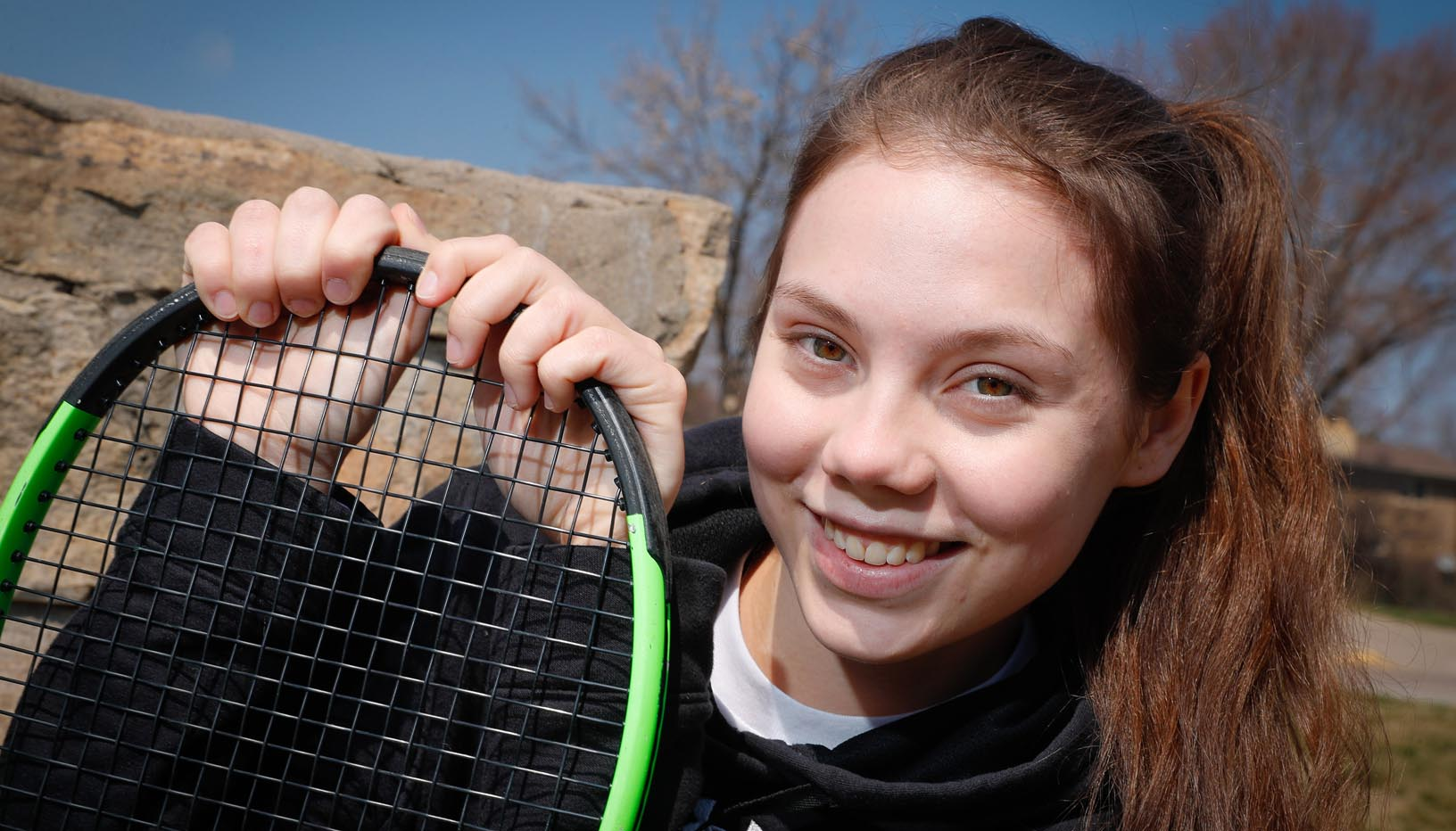 "Vasilisa Polunova, who moved from Russia to Kearney nearly a year ago, is enjoying the team aspect of collegiate tennis after a successful junior tennis career. ""It's like a family,"" she said of the UNK women's tennis team. ""They always support you and you can always talk to them."" (Photo by Corbey R. Dorsey, UNK Communications)"