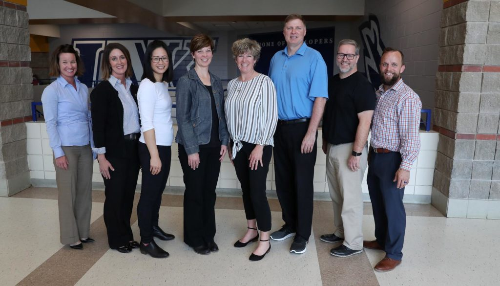 UNK and UNMC are collaborating on a five-year project supported by the Centers for Disease Control and Prevention that will address childhood obesity in rural communities. Members of the research team are, from left, Nancy Foster, Kaiti George, Tzeyu Michaud, Jennie Hill, Kate Heelan, Todd Bartee, Paul Estabrooks and Bryce Abbey. (Photo by Corbey R. Dorsey, UNK Communications)