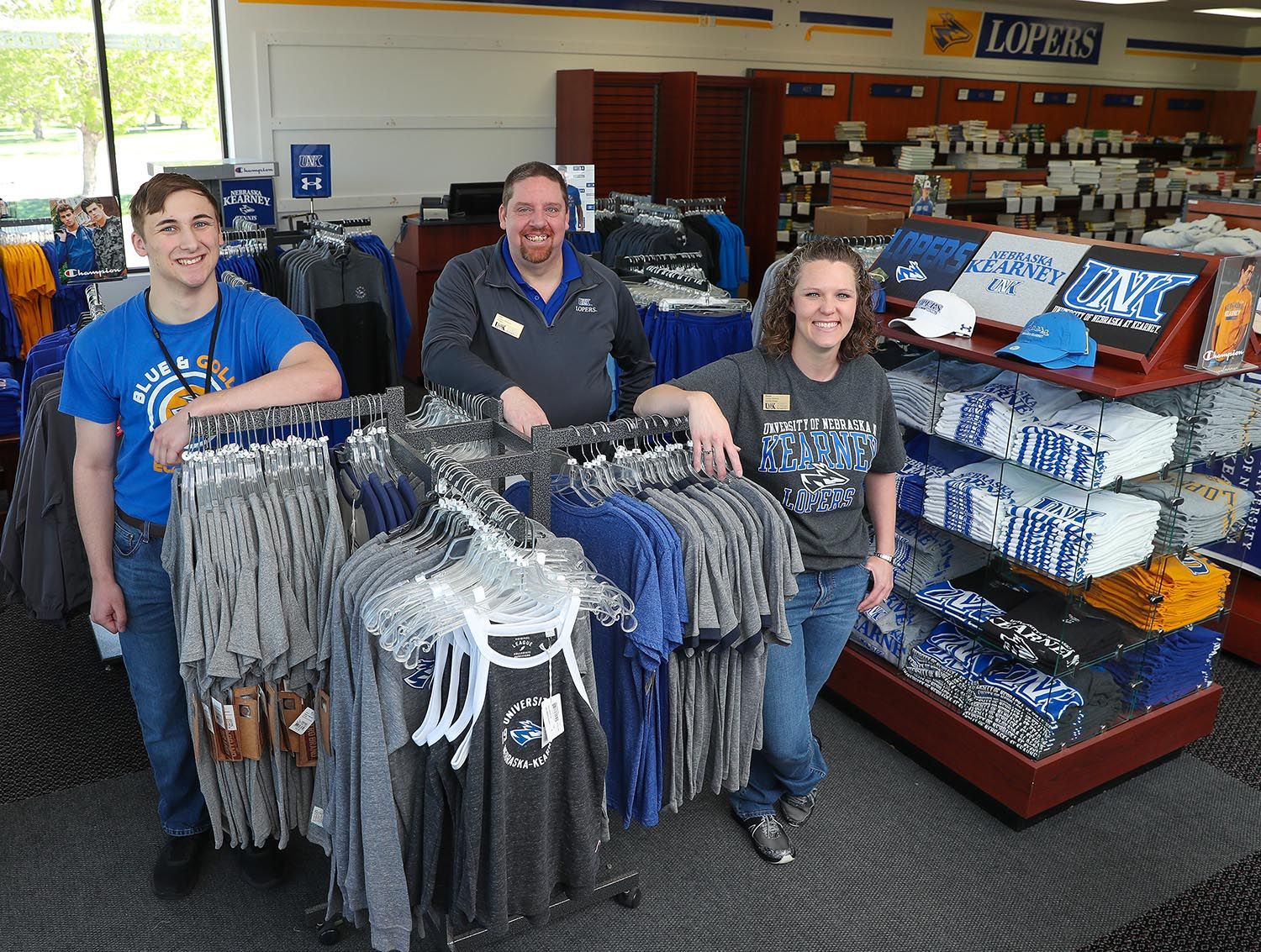 Antelope Bookstore staff, from left, Bodhi Jelinek, Len Fangmeyer and Dawn Bickford are preparing to move the store from its temporary location back to the Nebraskan Student Union on the UNK campus. (Photo by Corbey R. Dorsey, UNK Communications)