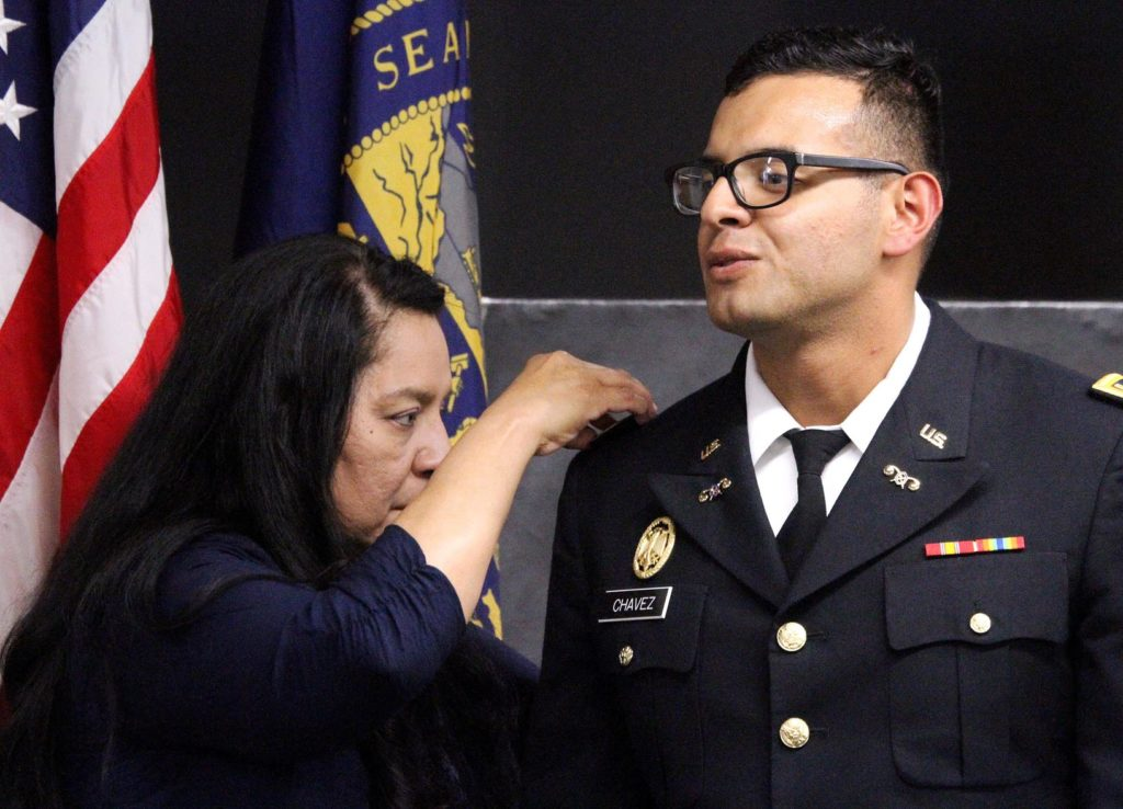 Armando Chavez has his new rank pinned by his mother, Rosa Torres, during an ROTC commissioning ceremony Friday at UNK. Chavez, who graduated Friday with a Bachelor of Arts in Education, will serve as a second lieutenant in the Nebraska Army National Guard's 67th Maneuver Enhancement Brigade in Lincoln. (Photo by Tyler Ellyson, UNK Communications)