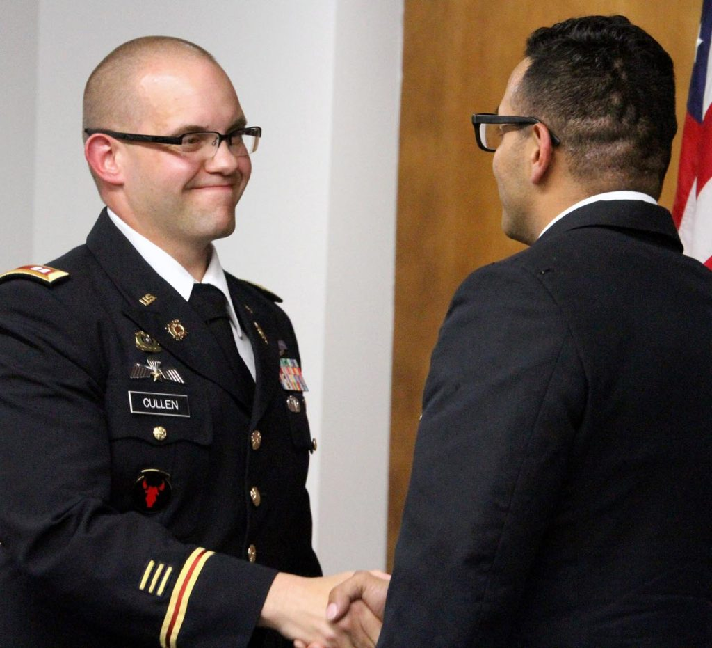 Capt. Damien Cullen, an assistant professor of military science, left, congratulates Armando Chavez during an ROTC commissioning ceremony Friday at UNK. Chavez, who graduated Friday with a Bachelor of Arts in Education, will serve as a second lieutenant in the Nebraska Army National Guard's 67th Maneuver Enhancement Brigade in Lincoln. (Photo by Tyler Ellyson, UNK Communications)