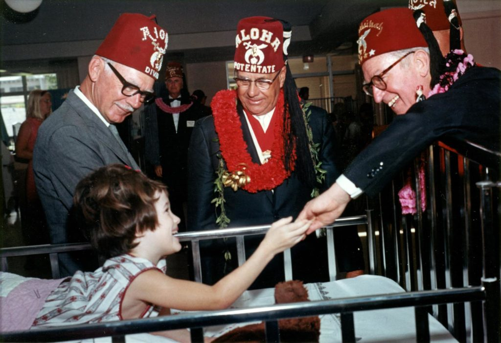 Jan Moore meets silent film star Harold Lloyd, right, at the Shriners Hospitals for Children in Honolulu in January 1967. (Courtesy photo)