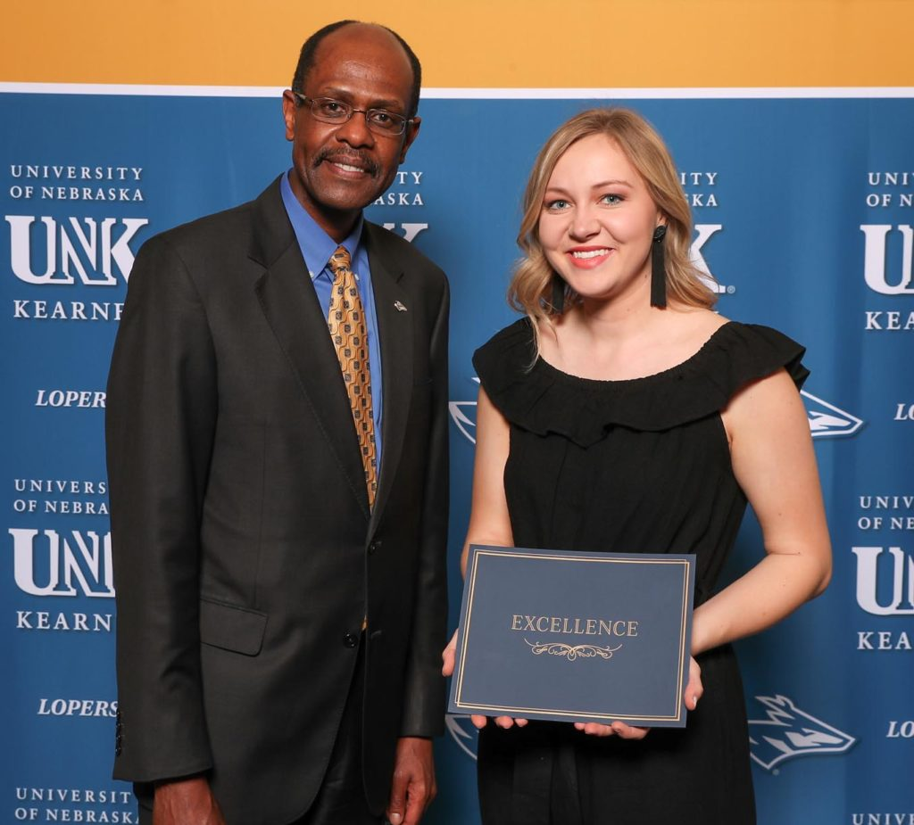 Katie Benner, shown with Dean of Student Affairs Gilbert Hinga, was named UNK's Greek Woman of the Year in recognition of her dedication to Alpha Omicron Pi and the entire sorority and fraternity community. (Photo by Corbey R. Dorsey, UNK Communications)