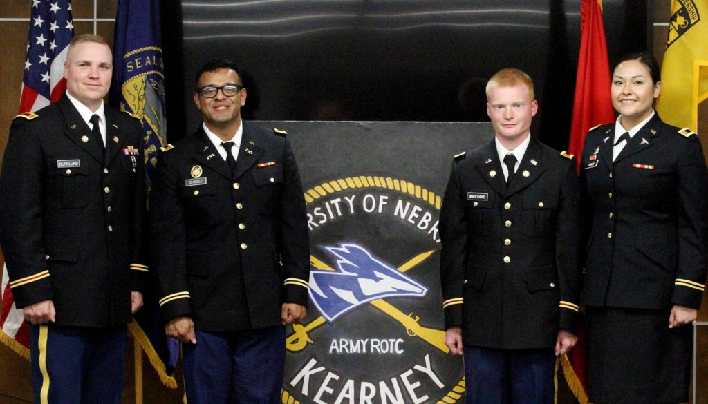 From left, ROTC cadets James Burklund, Armando Chavez, Cannon Marchand and Jeysel Olmos were commissioned as second lieutenants in the Nebraska Army National Guard during a ceremony Friday at UNK. Chavez, Marchand and Olmos also graduated from UNK that day. (Photo by Tyler Ellyson, UNK Communications)