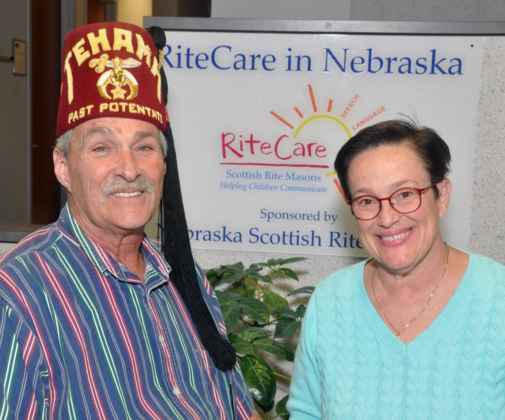 UNK professor Jan Moore is pictured with Scottish Rite Freemason Ron Nielsen in November 2018 at UNK's RiteCare Clinic, which provides speech therapy services for Nebraska children. (Photo courtesy of Rex Bavousett)
