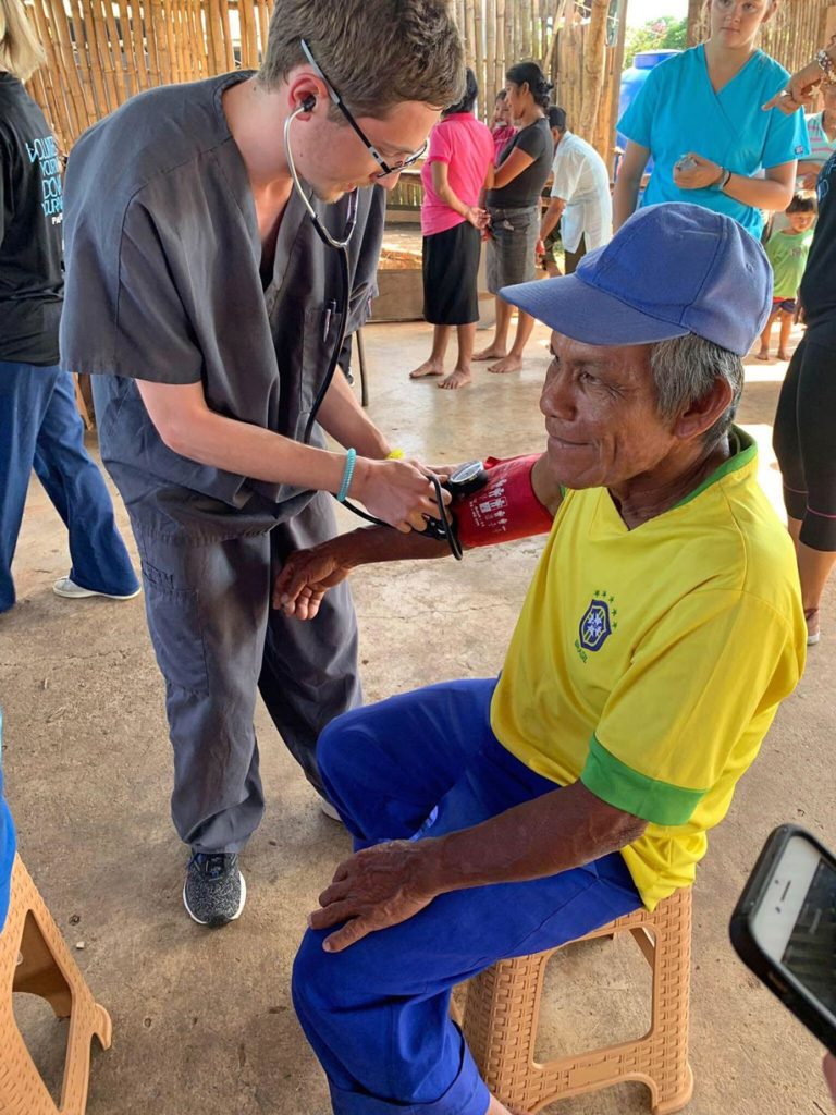 UNK student Bailey Premer checks a patient's vital signs at a mobile medical clinic in Panama. Twenty-one members of the UNK chapter of Volunteers Around the World traveled to the Central American country last month to work in mobile medical clinics that provided free care and medication to more than 300 patients. (Courtesy photo)