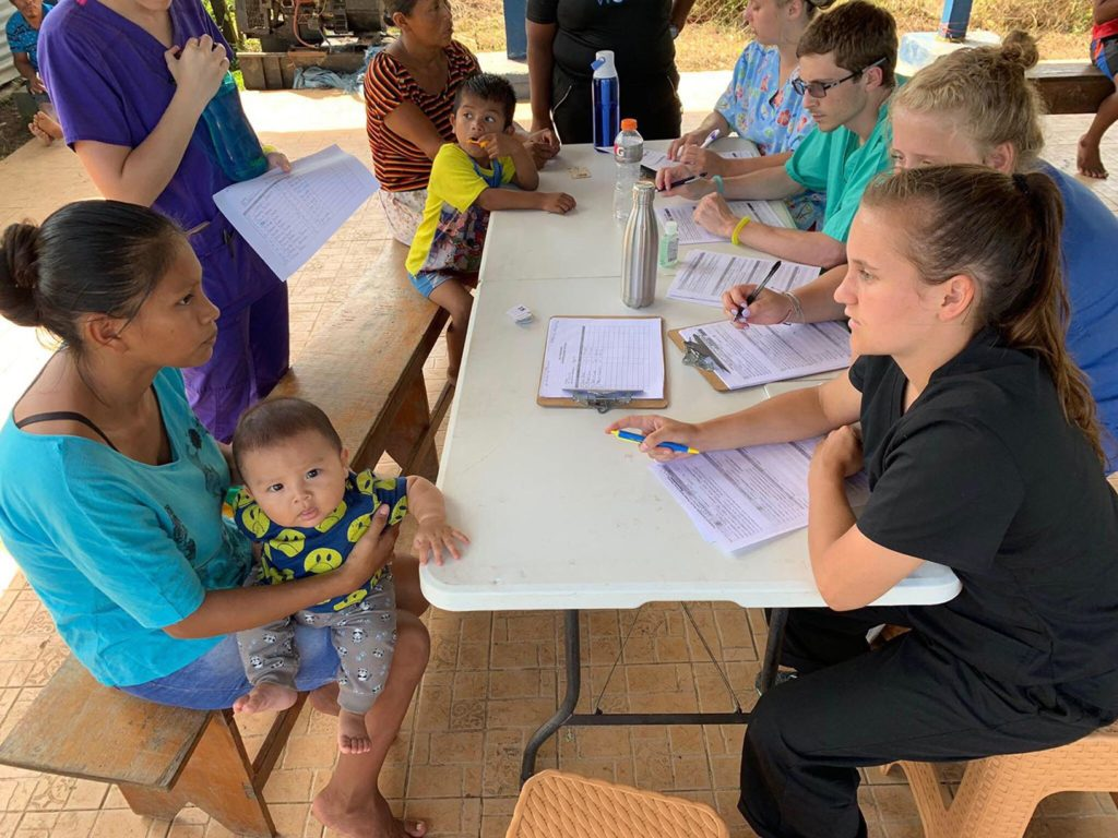 UNK students volunteer at a mobile medical clinic during a recent trip to Panama. (Courtesy photo)