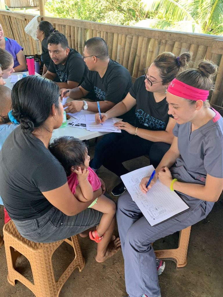 UNK student Kaitlyn Pineda, right, works with patients at a mobile medical clinic during a recent Volunteers Around the World trip to Panama. (Courtesy photo)