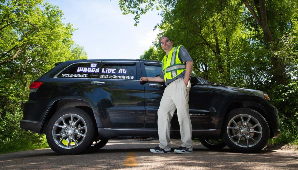 UNK employee Nathan Moore has been chasing thunderstorms and other severe weather for nearly three decades. He's the founder and part-owner of StormViewLIVE, a network of about 140 chasers across the country who livestream video and sell content to media networks. (Photo by Corbey R. Dorsey, UNK Communicatio