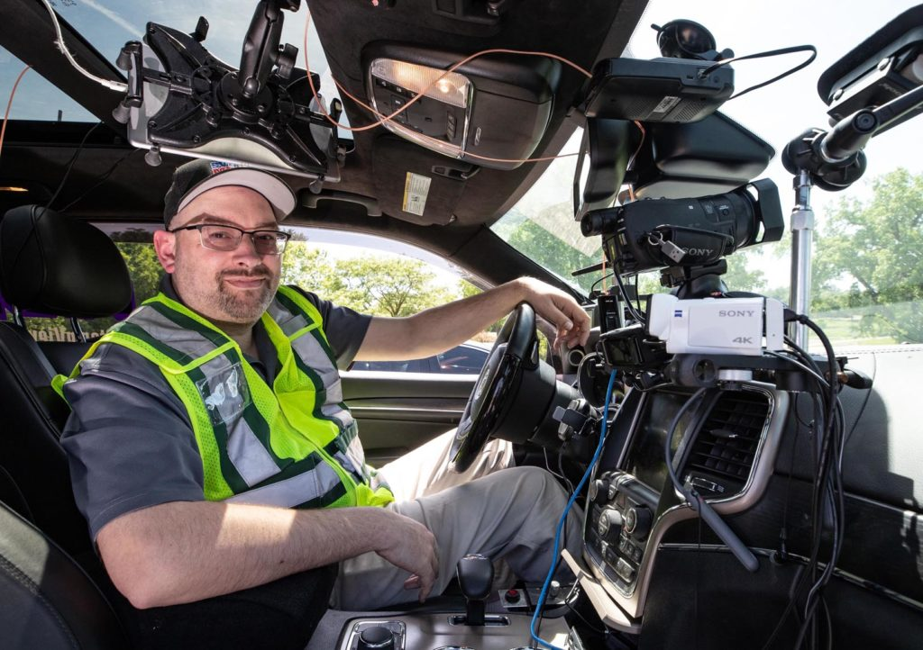 Nathan Moore uses a Sony camcorder, laptop computer, LiveView system and other technology while chasing and livestreaming severe weather. He also keeps a fold-up mattress inside his 2015 Jeep Grand Cherokee, in case he needs to sleep in the vehicle. (Photo by Corbey R. Dorsey, UNK Communications)