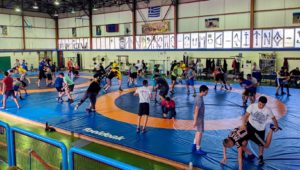 The UNK wrestling team trains with Atlas Kallitheas, the top wrestling club in Athens, during last month's trip to Greece. (Courtesy photo)