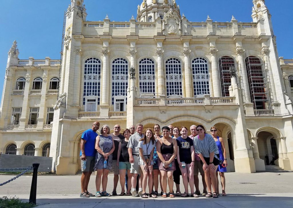 A group of 16 UNK students, faculty and community members traveled to Cuba last month for a weeklong stay. They're pictured at the Museum of the Revolution in Havana. (Courtesy photo)