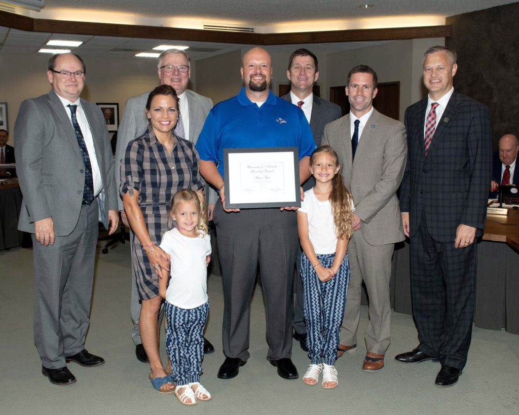 Ricci Fast was recognized at the Board of Regents meeting by UNK Chancellor Doug Kristensen, NU President Hank Bounds, UNK Police Chief Jim Davis and others. He was accompanied by his wife, Rachel, and their daughters Broxlynn and Beckitt.