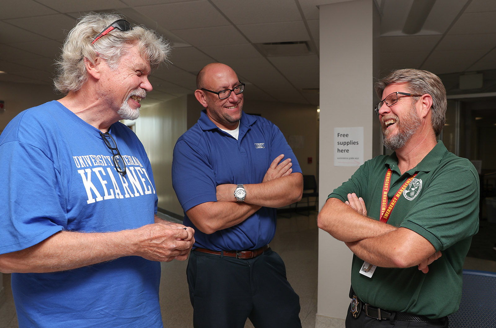 From left, Ken Labahn of La Grange, Illinois, chats with George Holman, UNK associate dean of student affairs and director of residence life, and Buffalo County Emergency Manager Darrin Lewis on Wednesday inside UNK's Centennial Towers West residence hall. Labahn was among the nearly 300 people impacted by Tuesday's flooding who stayed on the UNK campus. (Photo by Corbey R. Dorsey, UNK Communications)