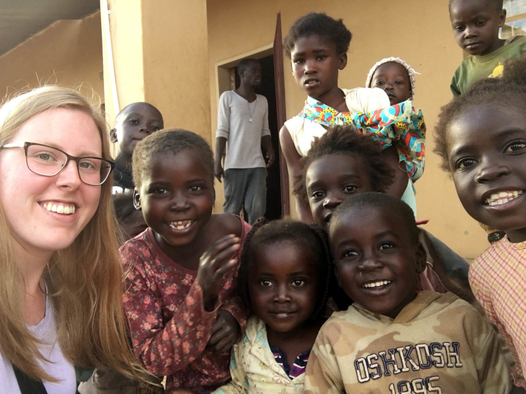 UNK student Michaela Walker snaps a selfie with a group of children in Zambia. (Courtesy photo)