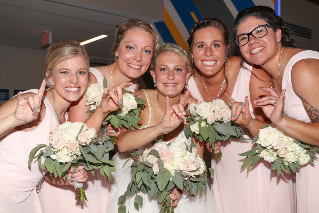 Megan Woeste, center, and her bridesmaids, from left, Bree Adams, Chelsea Leggott, Mackenzie Edgar and Fredde Reed all attended UNK and were members of the Alpha Omicron Pi sorority. They celebrated Woeste's wedding Saturday during a reception at UNK's Nebraskan Student Union. (Photo by Corbey R. Dorsey, UNK Communications)