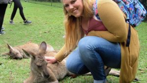 UNK junior Marissa Asche of Hebron pets a kangaroo while visiting the Australia Zoo during last month's study abroad trip. Asche and five other Lopers spent three weeks in Australia. (Courtesy photo)