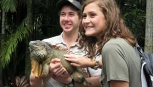Marlana Kent of Cambridge checks out an iguana at the Australia Zoo during a UNK study abroad trip. Kent and five other UNK students spent three weeks in Australia in July. (Courtesy photo)