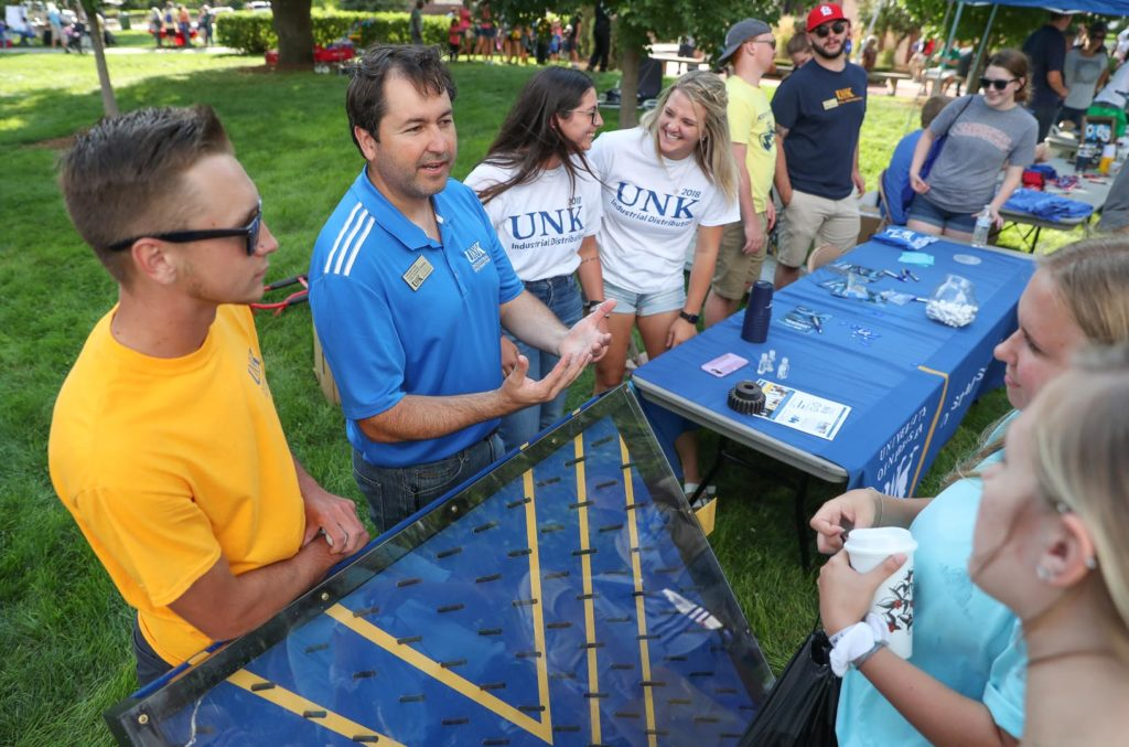 Alejandro Cahis, an industrial distribution lecturer at UNK, shares information about the program with attendees of Friday's Blue Gold Community Showcase on the UNK campus. (Photo by Corbey R. Dorsey, UNK Communications)