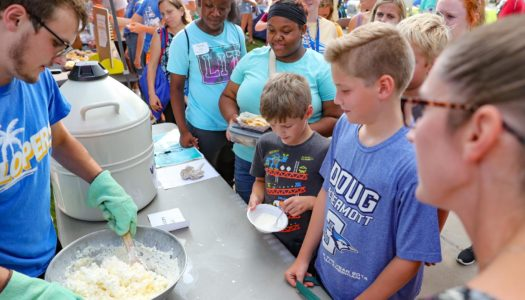 Jared Hunke, a senior from Holdrege, makes ice cream using liquid nitrogen to promote the UNK Chemistry Club during Friday's Blue Gold Community Showcase on the UNK campus. (Photo by Corbey R. Dorsey, UNK Communications)