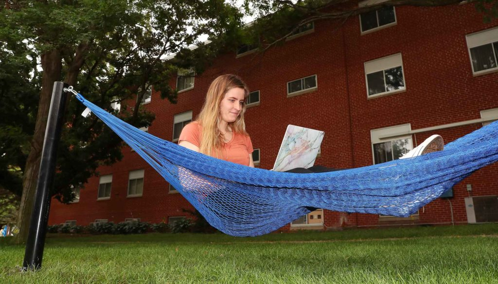 UNK student Megan Bahns of Leigh relaxes in one of 10 hammocks being installed on the UNK campus. The hammocks will be located near Centennial Towers East/Centennial Towers West, Randall Hall/Mantor Hall and the Nebraskan Student Union. (Photo by Corbey R. Dorsey, UNK Communications)
