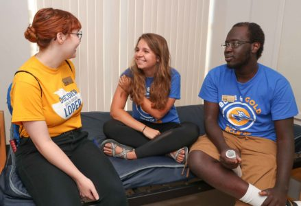 From left, UNK students Kyra Beuning, Emma Raders and Latjor Wal participate in a training session for resident assistants Monday at the Centennial Towers East residence hall. UNK's Office of Residence Life puts together a two-week training course that prepares RAs for the job. (Photo by Corbey R. Dorsey, UNK Communications)