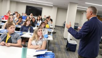 Tim Jares, dean of UNK's College of Business and Technology, speaks to Fremont High School students Tuesday during a visit to the UNK campus. The high schoolers toured campus, ate lunch in a dining hall and learned about UNK's supply chain management and industrial distribution programs. (Photo by Corbey R. Dorsey, UNK Communications)