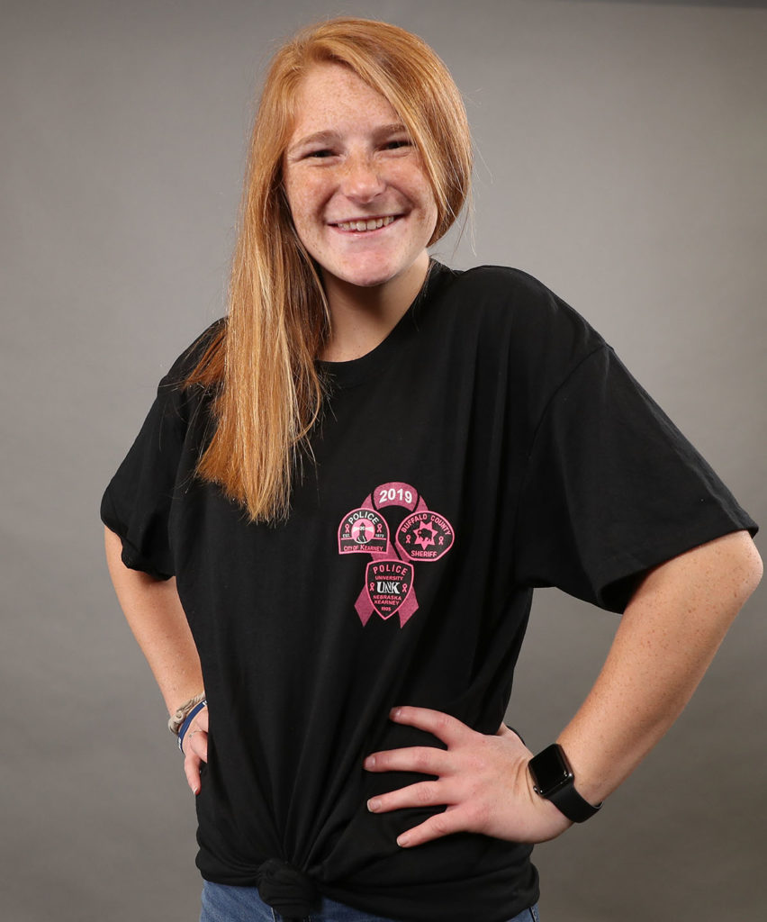 "UNK sophomore Taylor Mullen-Beck models the Pink Patch Project T-shirt that can be purchased at Hy-Vee, 5212 Third Ave., or online at <a href=""http://kpdpinkpatchproject.itemorder.com"">kpdpinkpatchproject.itemorder.com</a>."