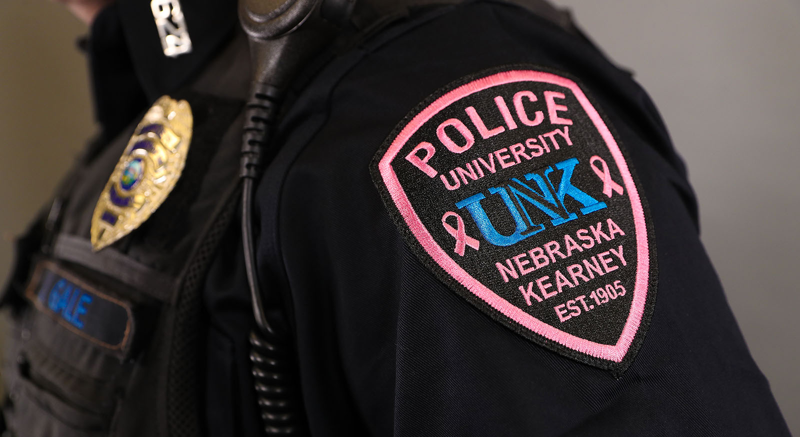 UNK Police officers will wear special pink patches throughout October to increase breast cancer awareness and raise money for those fighting the disease. The patches, created for the Pink Patch Project, can be purchased for $10 each at the Kearney/Buffalo County Law Enforcement Center, 2025 A Ave., with proceeds benefiting the local nonprofit Project Pink. (Photo by Corbey R. Dorsey, UNK Communications)