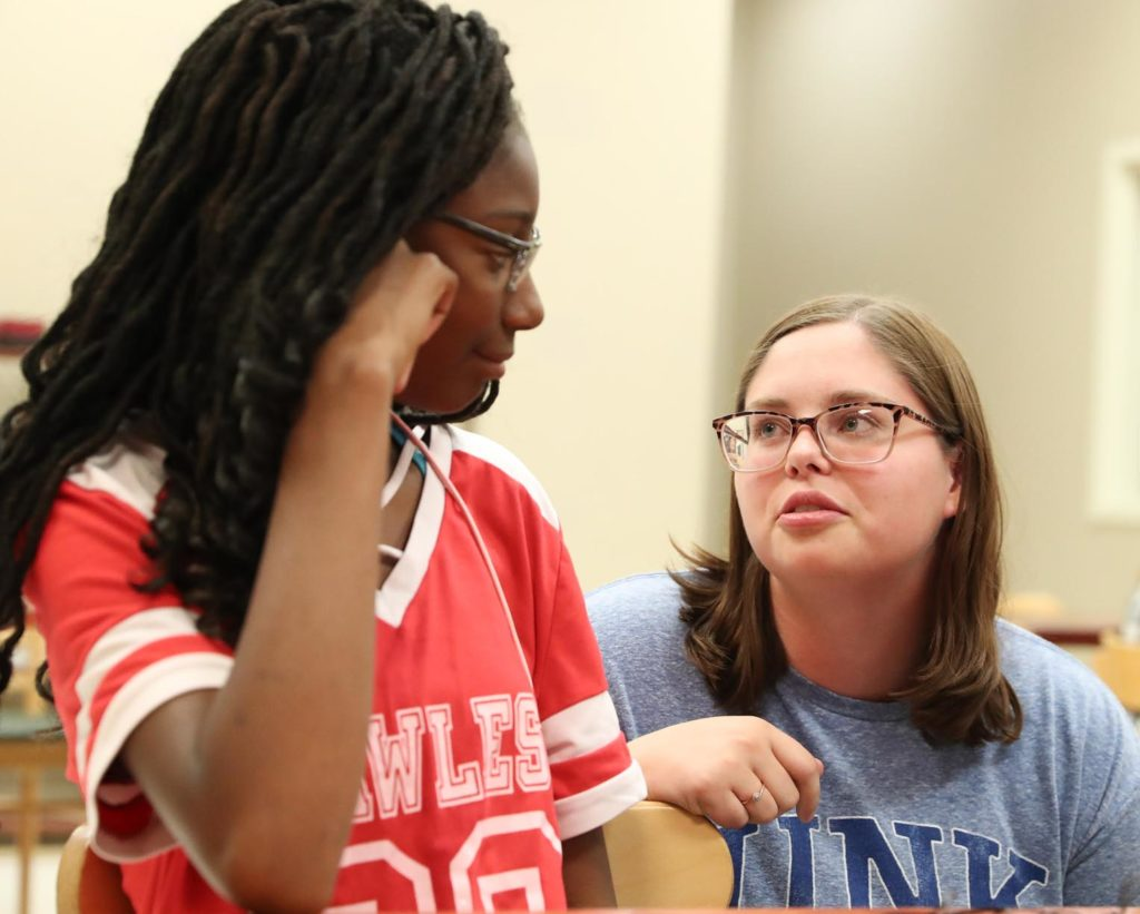 UNK senior Alyssa Donahey of Palmer, right, chats with Octavia Westbrooks on Friday while visiting the Crossroads Center homeless shelter in Kearney. Social work majors from UNK spent the day learning about a variety of resources available in the community. (Photo by Corbey R. Dorsey, UNK Communications)