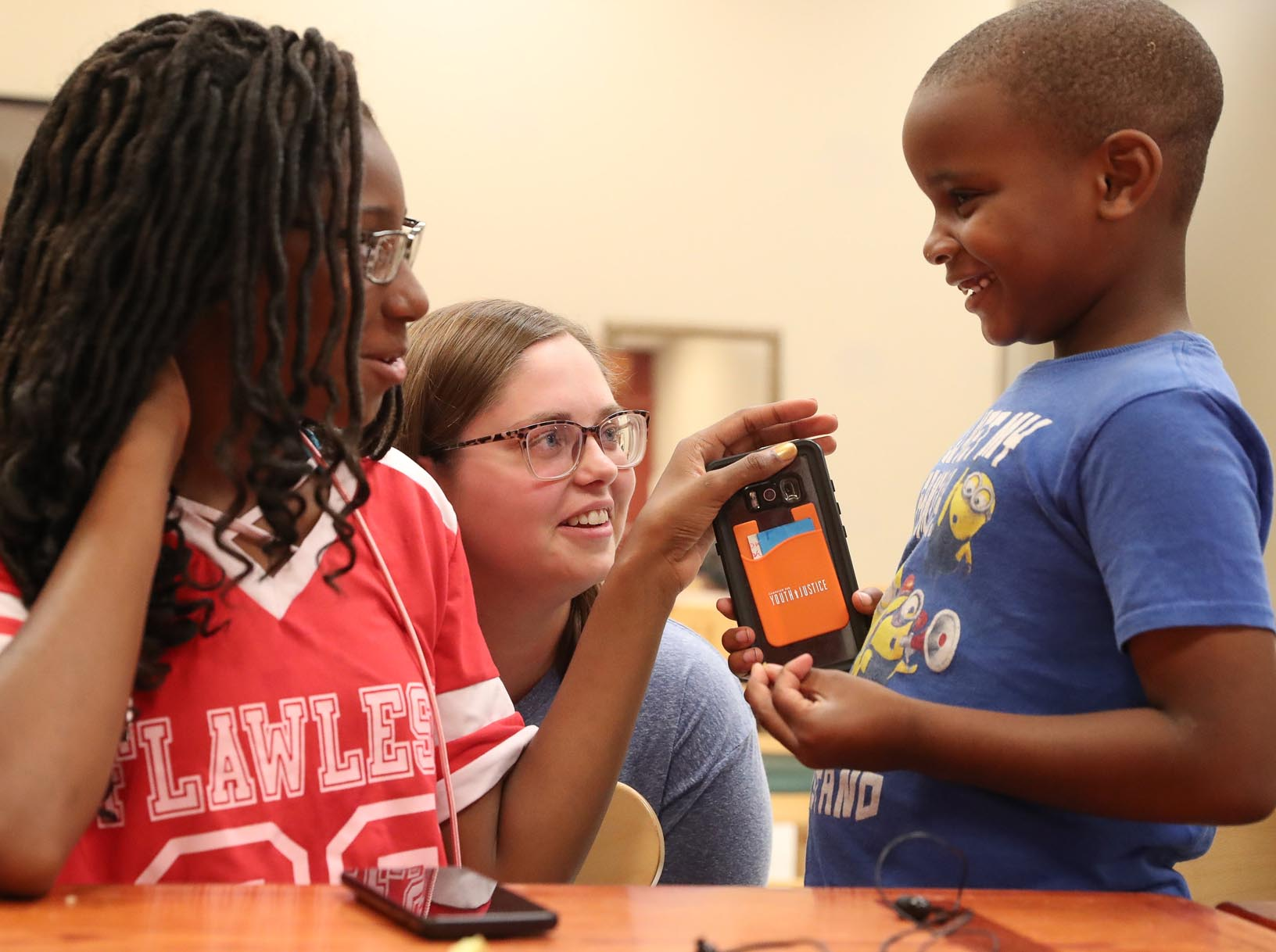 UNK senior Alyssa Donahey of Palmer, center, interacts with Octavia Westbrooks, left, and Braylen Fraklen on Friday at the Crossroads Center homeless shelter in Kearney. Social work majors from UNK spent the day learning about a variety of resources available in the community. (Photo by Corbey R. Dorsey, UNK Communications)