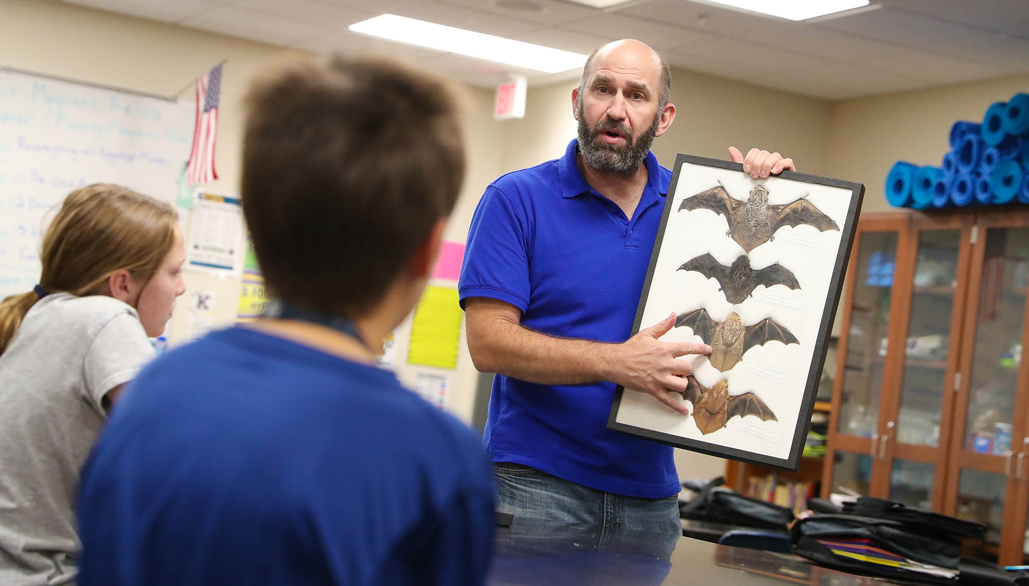 UNK biology professor Keith Geluso talks about different bat species during an Oct. 24 presentation at Horizon Middle School in Kearney. Geluso uses the presentations to educate students about bats, promote the animal's benefits and, hopefully, ease any fears.