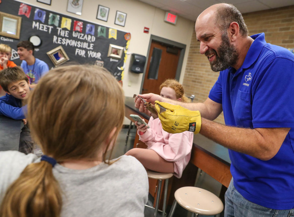 UNK biology professor Keith Geluso shows students a big brown bat during an Oct. 24 presentation at Horizon Middle School in Kearney. The bat expert has presented in schools throughout central and western Nebraska, as well as Ash Hollow State Historical Park and Indian Cave State Park.