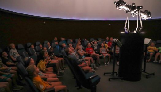 Elementary students learn about the solar system Monday during a presentation in the UNK planetarium. The activity was part of Early Awareness Day, an annual event that brought 73 area fourth graders to campus. (Photo by Corbey R. Dorsey, UNK Communications)