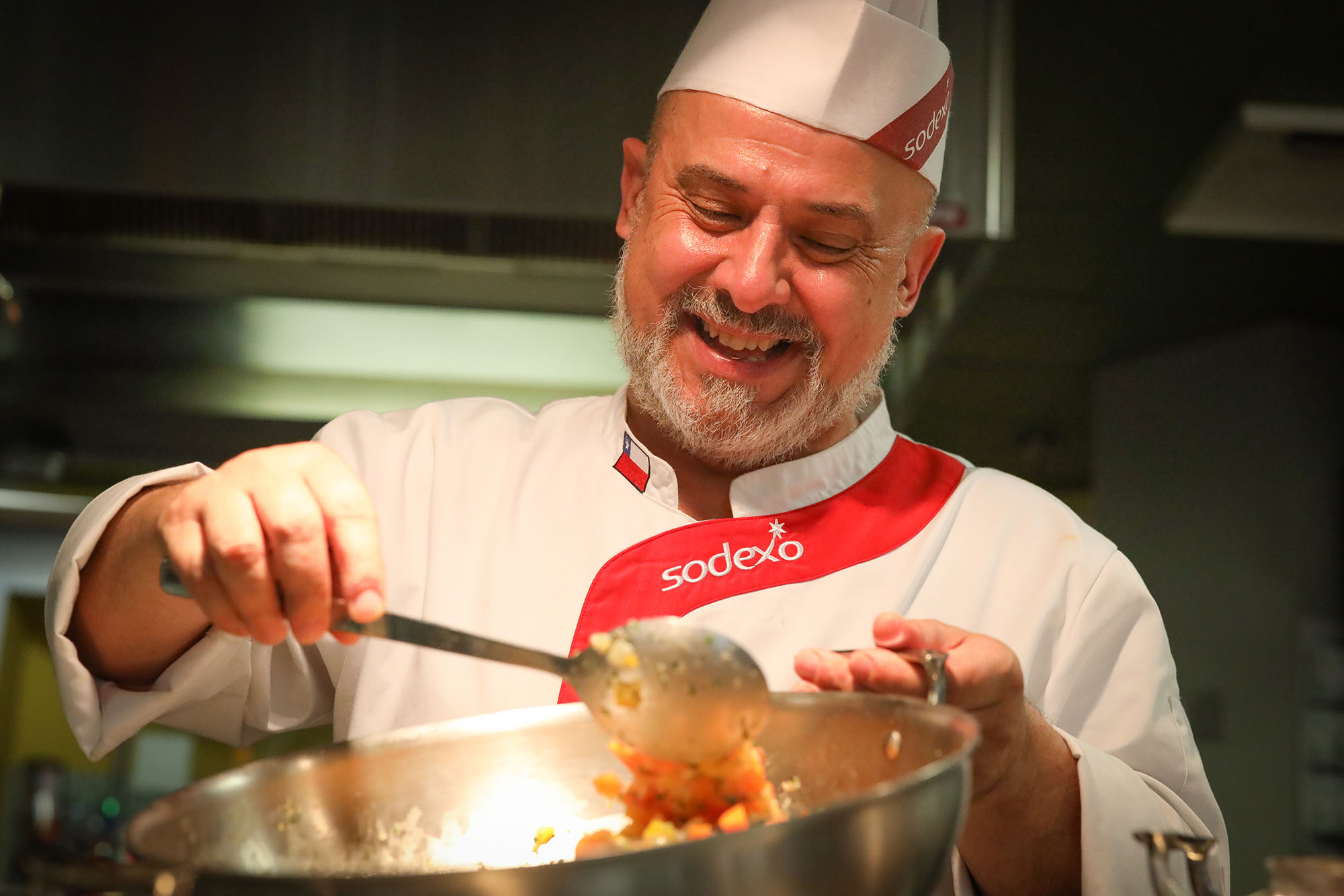 Francisco Layera, an executive chef with Sodexo Chile, prepares a dish from his home country to serve Monday evening at The Market @ 27th on the UNK campus. Layera cooked for UNK students, staff and faculty as part of Sodexo's Global Chef Program. (Photos by Corbey R. Dorsey, UNK Communications)