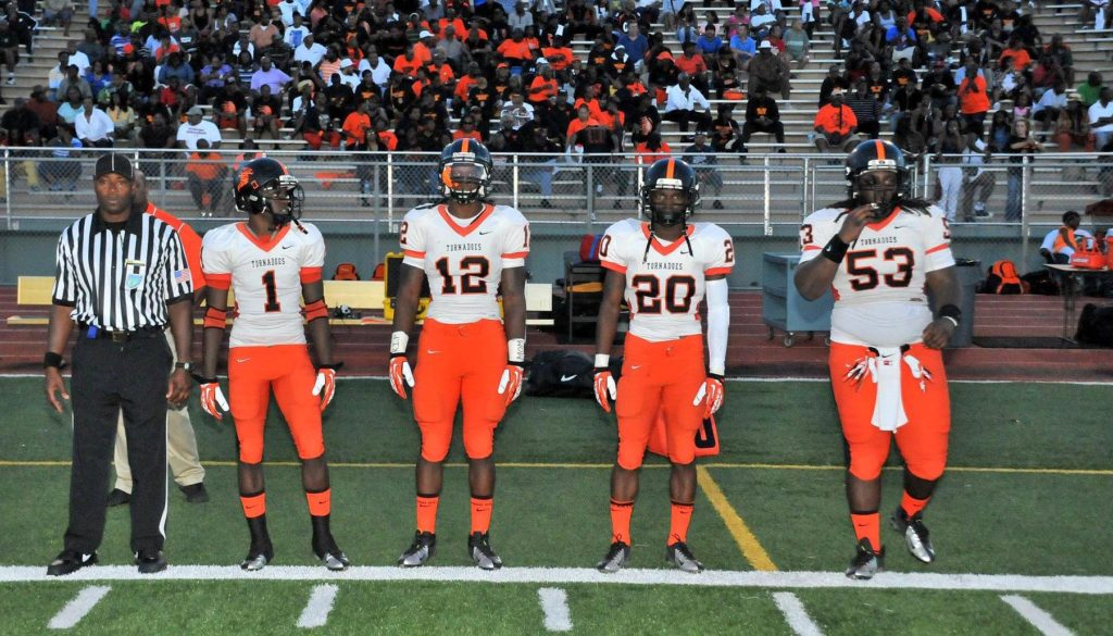 Jordan Ingraham, far right, started for three seasons at national high school powerhouse Booker T. Washington. The Tornadoes lost just three games during that span. They won back-to-back state titles and were named the national champion by USA Today following a 14-0 season in 2013. (Courtesy Photo)