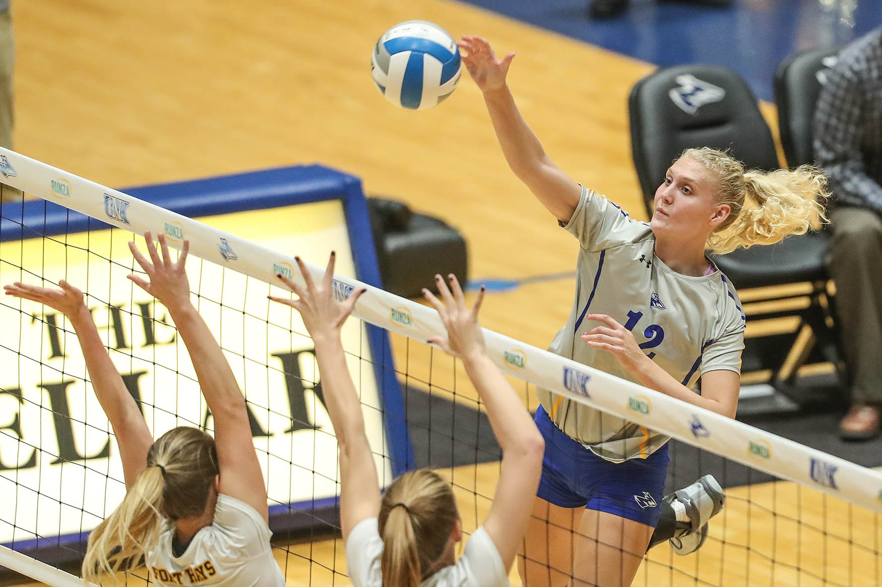 Senior middle blocker Mackenzie Puckett (12) is part of a UNK volleyball team that's posted a 125-9 record over the past four seasons and reached the NCAA Division II national tournament three times. (Photos by Corbey R. Dorsey, UNK Communications)