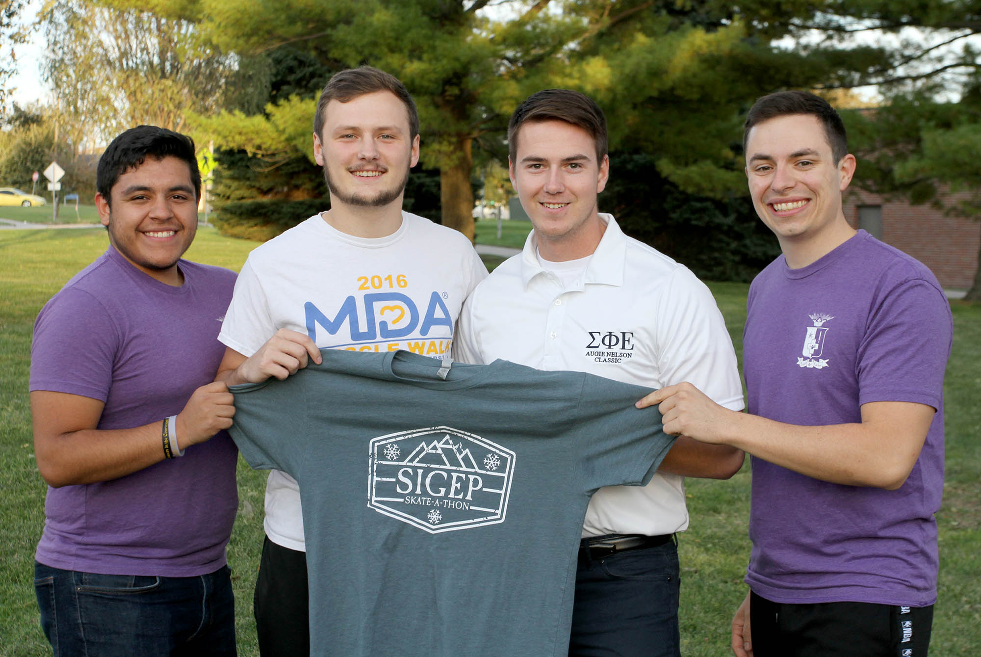 UNK's Sigma Phi Epsilon fraternity is hosting an MDA Skate and Walk event Sunday at the Viaero Center to raise money for the Muscular Dystrophy Association and its Nebraska summer camp. Pictured, from left, are fraternity members Agustin Ruvalcaba, Jared Hunke, Corey Johnson and Austin Jacobsen. (Photo by Tyler Ellyson, UNK Communications)