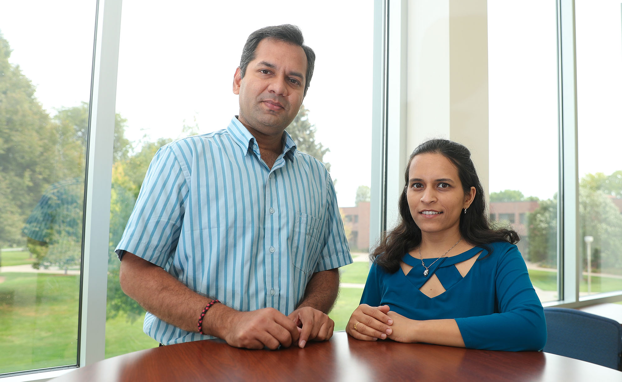 UNK researchers Mahesh Pattabiraman, left, and Surabhi Chandra are trying to develop a painkiller that's as effective as opioids, without the risk of addiction. (Photos by Corbey R. Dorsey, UNK Communications)