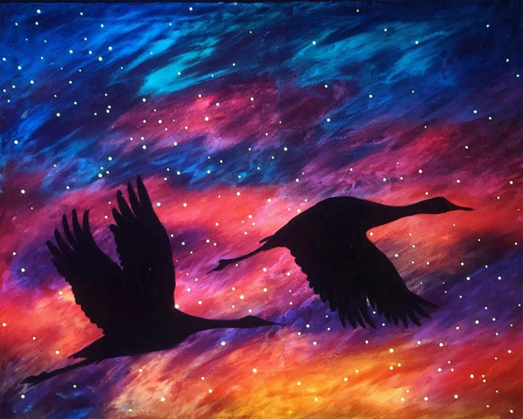 UNK student Nicole Mittman created this glow-in-the-dark painting of sandhill cranes. (Courtesy image)
