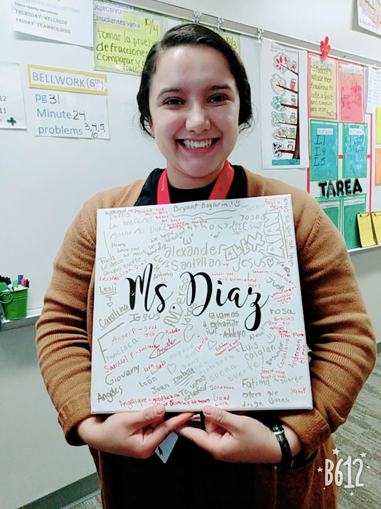 Emely Diaz, a first-generation UNK student, displays a canvas signed by students at Norris Middle School in Omaha. Diaz gained hands-on experience in classrooms in Kearney, Lexington and Omaha before she started student teaching this semester at RM Marrs Magnet Center, which is part of Omaha Public Schools.