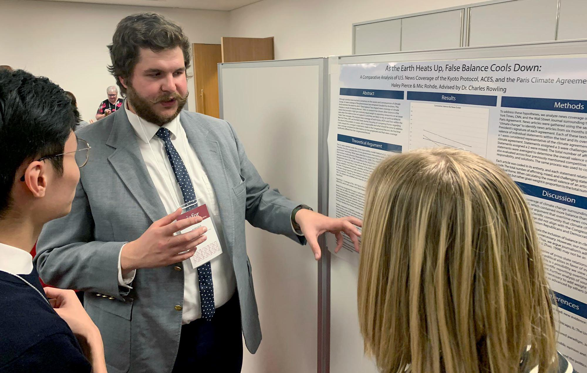 Mic Rohde of Kimball discusses his research during the Asian Undergraduate Research Symposium in Tokyo. Rohde and fellow UNK senior Haley Pierce of West Point presented their analysis of U.S. news coverage of the Kyoto Protocol, American Clean Energy and Security Act and Paris Agreement. (Courtesy photos)