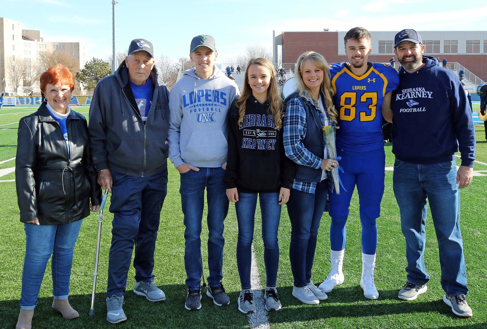 UNK football player Mitch Carlson, second from right, poses for a photo with his family during Saturday's Senior Day festivities at Cope Stadium. Pictured, from left, are Carlson's grandparents Donna and Rich Myers, his siblings Connor and MaKenna and his parents Tammy and Brad. (Photo by Todd Gottula, UNK Communications)