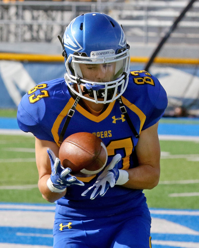 Mitch Carlson, a wide receiver on the UNK football team, warms up before Saturday's home game against Washburn. (Photo by Todd Gottula, UNK Communications)