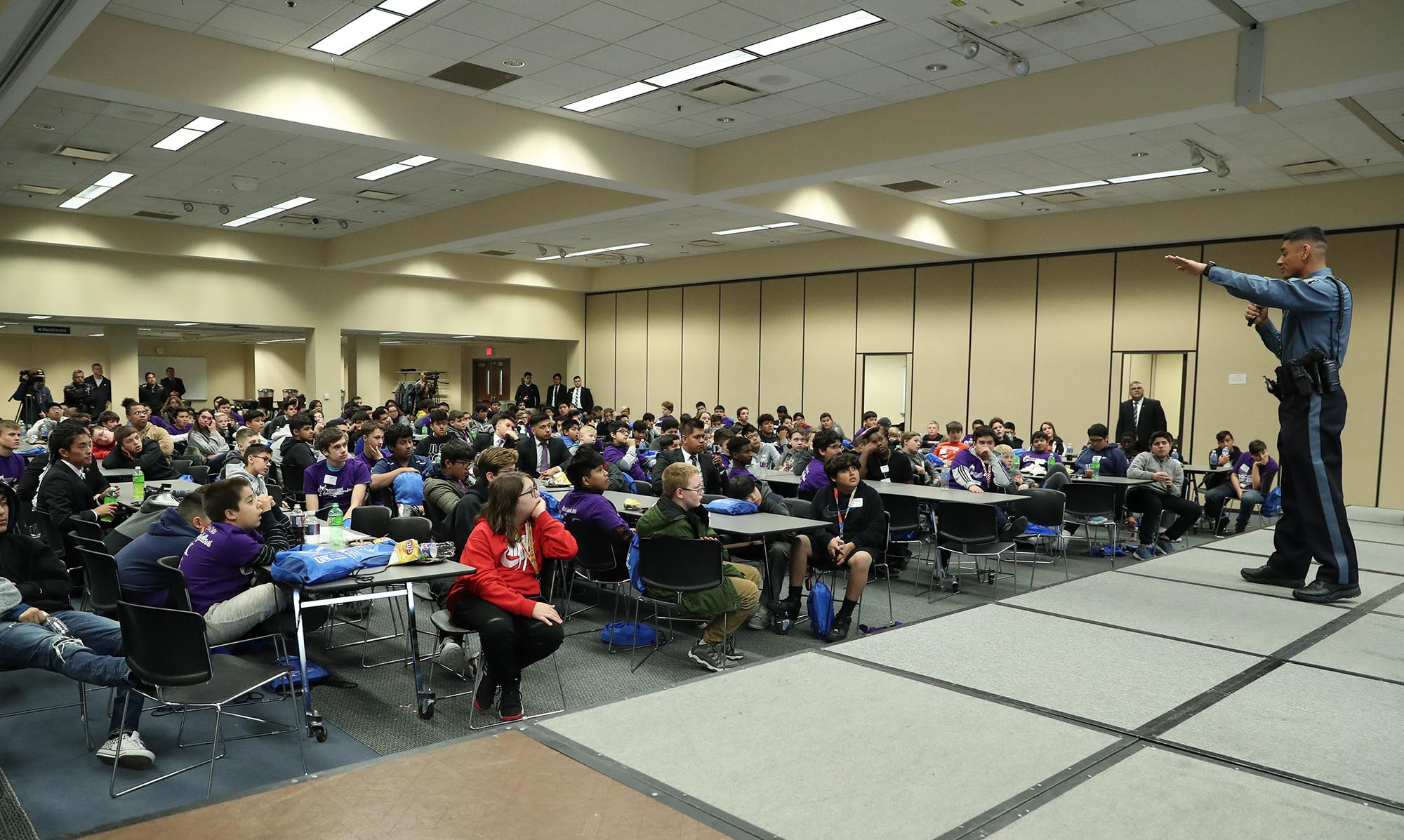 Gustavo Ramirez, a state trooper with the Kansas Highway Patrol, talks to middle school students from Schuyler, Columbus, Grand Island, Kearney, Lexington and Hastings during Friday's Youth Empowerment Conference at UNK. (Photos by Corbey R. Dorsey, UNK Communications)