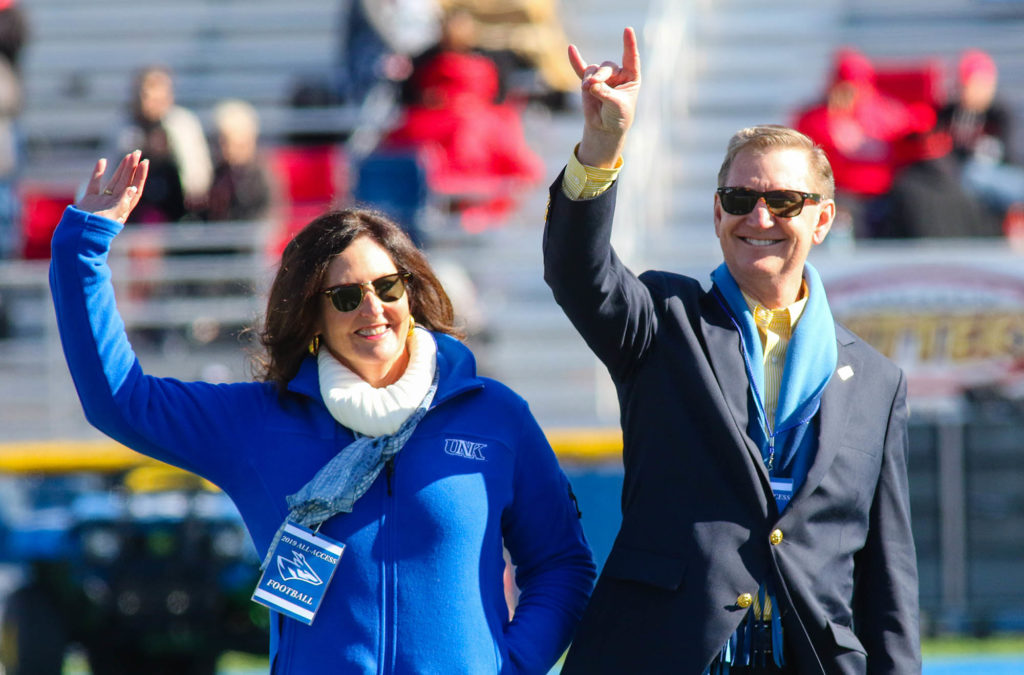 Ted Carter and his wife Lynda are introduced during UNK's home football game Saturday at Cope Stadium. (Photo by Todd Gottula, UNK Communications)