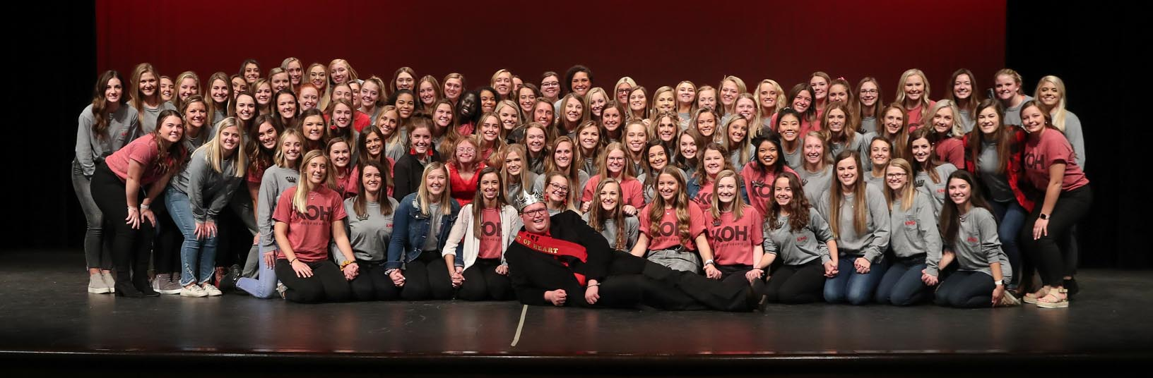 Adam Schultis poses with members of the Alpha Phi sorority after he was named Mr. King of Hearts during Thursday evening's fundraiser at Kearney High School. (Photos by Corbey R. Dorsey, UNK Communications)