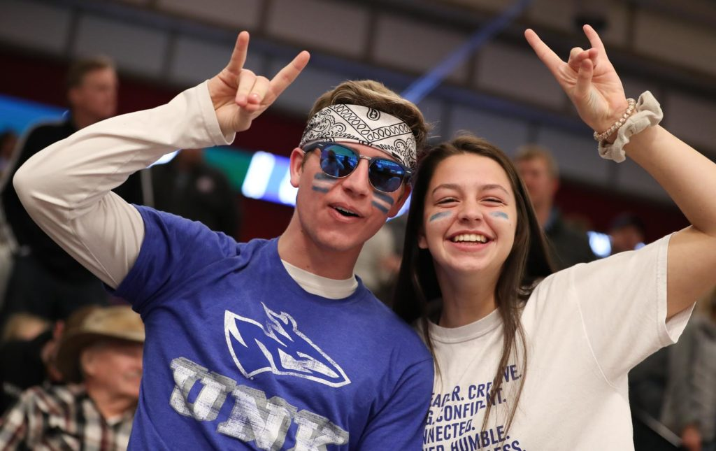 "UNK fans ""throw the Lopes"" during Saturday's NCAA Division II women's volleyball championship at the Auraria Event Center in Denver."