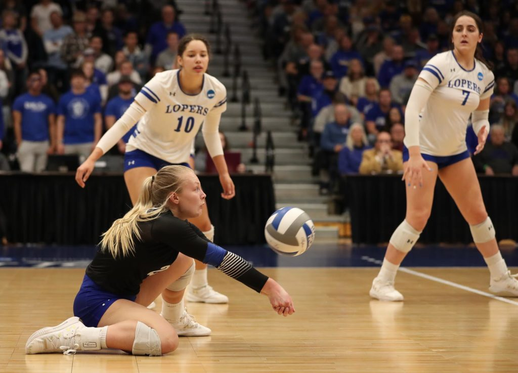 Sophomore libero Lindsay Nottlemann digs a ball as UNK teammates Julianne Jackson (10) and Anna Squiers (7) look on Saturday during the NCAA Division II women's volleyball championship at the Auraria Event Center in Denver.