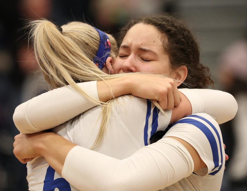 Senior outside hitter Julianne Jackson, right, embraces junior setter Maddie Squiers after UNK's loss to Cal State San Bernardino in Saturday's NCAA Division II national championship match at the Auraria Event Center in Denver.